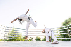 Capoeira, a woman and a man struggling in the outdoors Stock Images