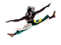 Capoiera brasileño del baile del bailarín del hombre negro Foto de archivo