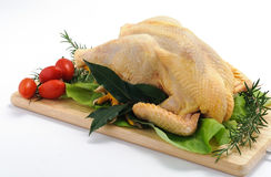 Capon on cutting board Stock Photo