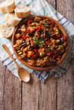 Caponata with aubergines in a wooden plate. vertical top view Stock Images