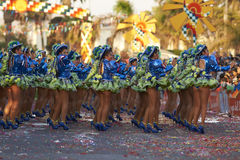 Caporales Dance Group - Arica, Chile. Female members of a Caporales dance group in ornate green and blue costumes performing at the annual Carnaval Andino con la royalty free stock images