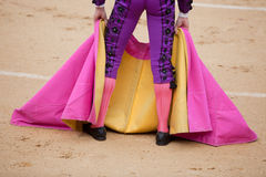 Capote. The bullfighter waits the bull with the capote during a bullfight Royalty Free Stock Photos