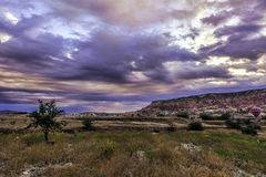 Cappadoccia view during dawn, early morning under under cloudy orange blue sky Royalty Free Stock Photo