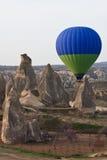 Cappadocia ballon. Hot air balloon over rock formations in Cappadocia, Turkey Stock Images
