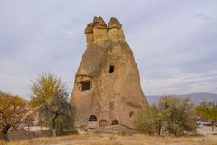Cappadocia cabes in tuff formations landscape at cloudy day Stock Image