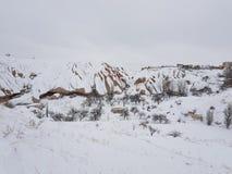 Cappadocia debajo de la nieve fotografía de archivo