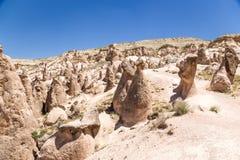 Cappadocia, die Türkei Berglandschaft mit Säulen von Verwitterung (Felsnasen) im Devrent-Tal Lizenzfreie Stockfotografie