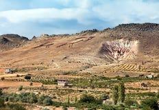Cappadocia - The Land of Horses. Name Cappadocia means: Cappadocia - The Land of Beautiful Horses. And it's the Cappadocias rocky 'logo' on one hill Stock Photo