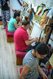 CAPPADOCIA - MAY 17 : Woman working at the manufacture of carpet Royalty Free Stock Photography