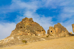 Cappadocia rock towers with caves Stock Image