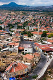 Cappadocia Roof Tops, birds eye. Small mountain town, red tiled roofs and winding road. Cloudy day in  Goreme, Cappadocia, Turkey Royalty Free Stock Photography