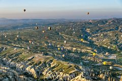 Hot air balloon over landscape of Cappagocia in Turkey Royalty Free Stock Image