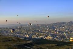 Hot air balloon over landscape of Cappagocia in Turkey Stock Photos