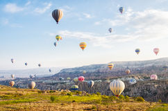 CAPPADOCIA TURKEY. APRIL 12 ,2013 : tourists fly over the amazing landscape of Cappadocia , on the hot air balloons Stock Image