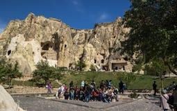 Cappadocia, Turkey - April 29, 2014: Tourists visiting Cave Church at Goreme in Nevsehir. Stock Photo