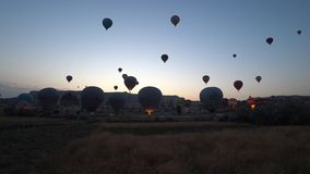 Timelapse of hot air balloons rising in Cappadocia, Turkey. Cappadocia, Turkey - August 2017: Timelapse of hot air balloons rising in Cappadocia, Turkey stock footage