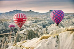 Hilly landscape and balloon. Balloons. Goreme, Cappadocia - Landmark attraction in Turkey Stock Images