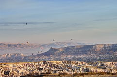 Balloon. Hilly landscape and balloons - Landmark attraction in Goreme, Cappadocia - Turkey Stock Image