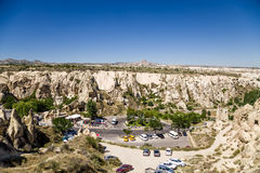 Cappadocia, Turkey. Car parking in the canyon in front of the Open Air Museum in Goreme National Park Royalty Free Stock Photo