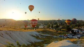 Dozens of hot air balloons launch at dawn over Goreme. Cappadocia, Turkey - 2019: dozens of hot air balloons launch at dawn over Goreme stock video footage