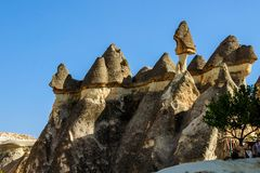 Cappadocia, Turkey. Fairy Chimney. Multihead stone mushrooms in the Valley of the Monks. Pasabag Valley.  Royalty Free Stock Image