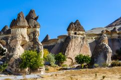 Cappadocia, Turkey. Fairy Chimney. Multihead stone mushrooms in the Valley of the Monks and St. Simon Church. Pasabag Valley.  Royalty Free Stock Image