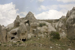 Cappadocia turkey. Cappadocia is a fascinating area in turkey where the rock is conducive to cutting.  The area is honeycombed with carved openings which were Stock Photos