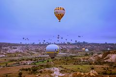 Cappadocia, Turkey - JUNE 01,2018: Festival of Balloons. Flight on a colorful balloon between Europe and Asia. Fulfillment of desi. Res. Extreme. Scenic view Stock Image