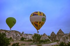 Cappadocia, Turkey - JUNE 01,2018: Festival of Balloons. Flight on a colorful balloon between Europe and Asia. Fulfillment of desi. Res. Extreme. Scenic view Royalty Free Stock Images