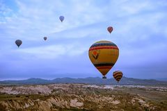 Cappadocia, Turkey - JUNE 01,2018: Festival of Balloons. Flight on a colorful balloon between Europe and Asia. Fulfillment of desi. Res. Extreme. Scenic view Royalty Free Stock Photo