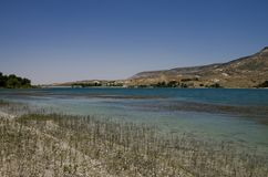 Lake with light blue water in the South Cappadocia Valley. stock image