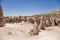 Cappadocia, Turkey. Landscape with beautiful figures of weathering in a mountain valley Royalty Free Stock Photo