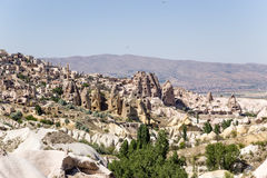 Cappadocia, Turkey. The lower part of the rock - fortress Uchisar and the surrounding picturesque valley Royalty Free Stock Photos