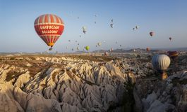 CAPPADOCIA, TURKEY - MAY 04, 2018: Hot air balloon flying over r stock image