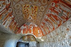 Wall art of old frescoes  and murals in the underground cave churches of Cappadocia. Cappadocia ,Turkey - October 20 ,2016 : Wall art of old frescoes  and murals Stock Image