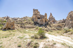 Cappadocia, Turkey. Picturesque cliffs with caves inside them in Goreme National Park Royalty Free Stock Photos