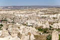Cappadocia, Turkey. The picturesque mountain valley with pillars of weathering and Uchisar town Royalty Free Stock Images