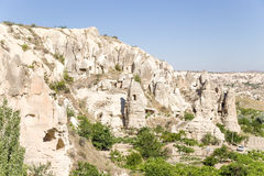 Cappadocia, Turkey. Picturesque pillars of weathering with artificial caves in the National Park of Goreme Royalty Free Stock Photo