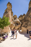 Cappadocia, Turkey. Tourists visiting cells carved into the rocks in the Valley of the Monks (Pashabag) Stock Image