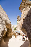 Cappadocia, Turkey. Tourists visiting the monks' cells in the rocks in the Valley Pashabag (Monks Valley) Stock Images