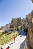 Cappadocia, Turkey. Tourists visiting the ruins of the  Royalty Free Stock Image