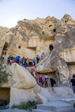 Cappadocia, Turkey. Tourists visiting the ruins of the medieval  Stock Image