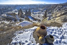 Cappadocia. Turkey. View from mountain on the unusual winter landscape with cliffs at morning time. Landscape of Cappadocia with traditional jugs Stock Photography