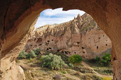 Hilly landscape. Cappadocia - landmark attraction in Turkey. Hilly landscape. Volcanic formations converted into dwelling - Cappadocia, landmark attraction in Royalty Free Stock Image
