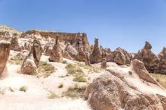 Cappadocia Turkiet Nyckfulla diagram av att rida ut i dalen Devrent Royaltyfria Bilder