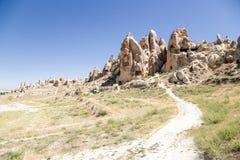 Cappadocia, Turquía Rocas, llenadas de las cuevas artificiales en el parque nacional de Goreme Imagen de archivo libre de regalías