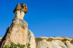 Cappadocia, Turquia Chaminé feericamente Multihead apedreja cogumelos no vale das monges Vale de Pasabag Fotografia de Stock Royalty Free