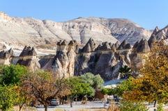 Cappadocia, Turquia Chaminé feericamente Multihead apedreja cogumelos no vale das monges e do St Simon Church Vale de Pasabag Fotografia de Stock Royalty Free
