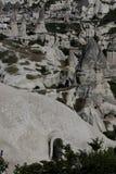 Cappadocia, vista delle case in pietre e in prou storico insolito Immagini Stock