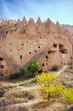 Volcanic formations - Landmark attraction in Cappadocia, Turkey. Volcanic formations converted into dwelling - Landmark attraction in Cappadocia, Turkey Stock Photography